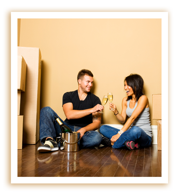 First Time Homebuyers drinking champagne.