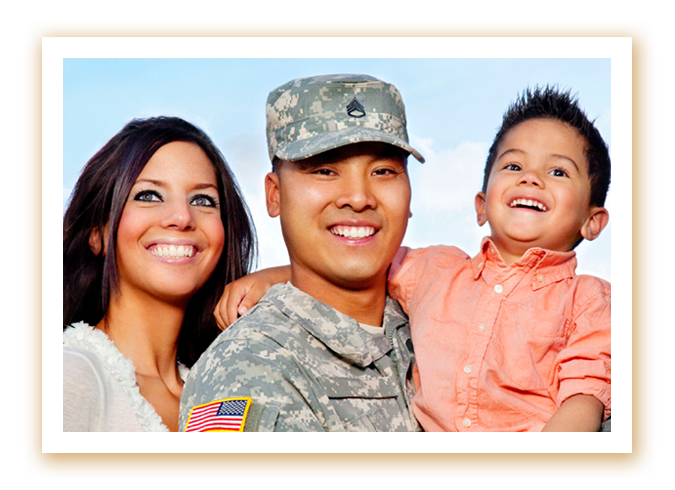 A U.S. Soldier holding a child, with spouse.